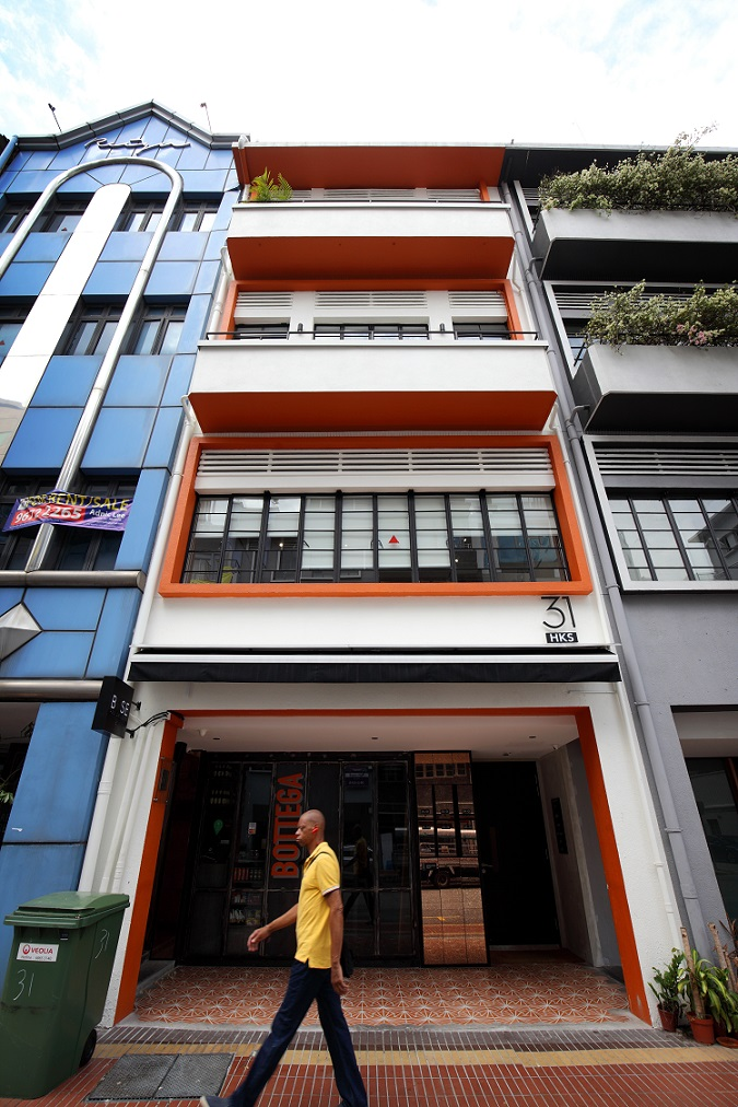 This shophouse at 31 Hongkong Street has been converted into four serviced apartments branded BASE Residences by 8M Real Estate