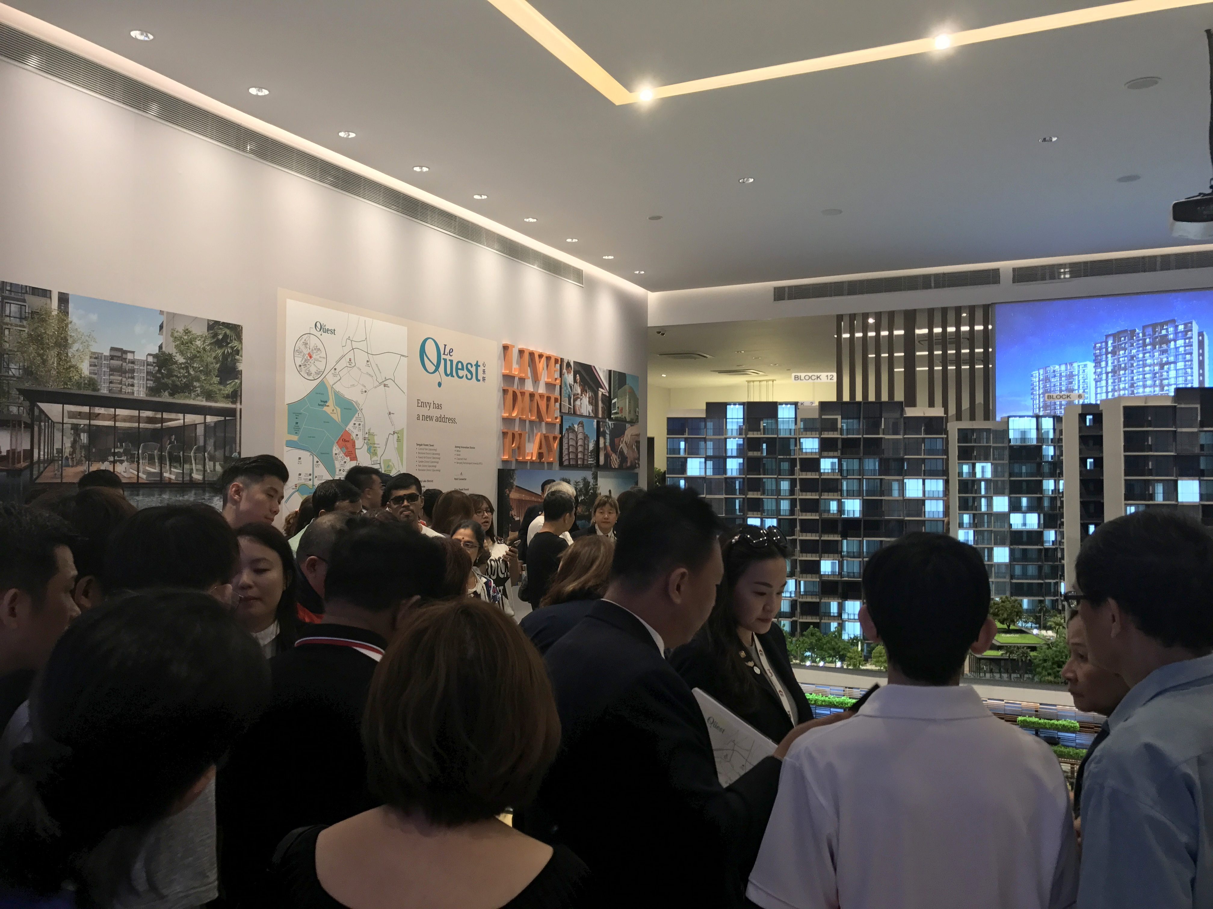 The crowd at Le Quest's sales gallery